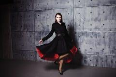 Elegant young woman posing in coat, hoto Studio Stock Photos