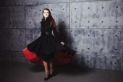 Elegant young woman posing in coat, hoto Studio Royalty Free Stock Photography