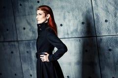 Elegant young woman posing in coat, hoto Studio Stock Images