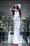 Elegant woman posing in long white dress Royalty Free Stock Image