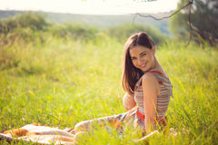 Elegant young woman posing in sunny park Royalty Free Stock Images