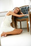Elegant young woman resting on chair Royalty Free Stock Photo