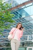 Elegant young woman sending text message on mobile phone Stock Images