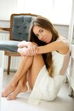 Elegant young woman sitting on floor at home Royalty Free Stock Photos