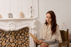 Elegant young woman sitting reading Royalty Free Stock Photo