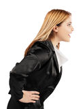 Elegant young woman speaking in profile position Royalty Free Stock Images
