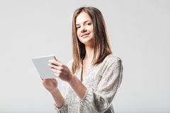 Elegant young woman with tablet Royalty Free Stock Photography