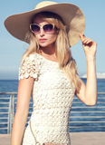Elegant young woman on vacation. Royalty Free Stock Image