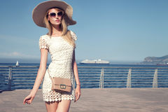 Elegant young woman on vacation. Royalty Free Stock Photography