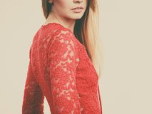 Elegant young woman wearing red top. Elegant young woman wearing red lace top. Female presentig stylish fashionable outfit Stock Images