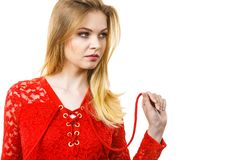 Elegant young woman wearing red top. Elegant young woman wearing red lace top. Female presentig stylish fashionable outfit Stock Photos