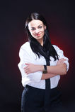 Elegant young woman in white shirt. Elegant young woman in white mens shirt with black necktie, studio shot Royalty Free Stock Photography