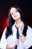 Elegant young woman in white shirt Stock Image