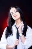 Elegant young woman in white shirt. Elegant young woman in white mens shirt with black necktie, studio shot Stock Image