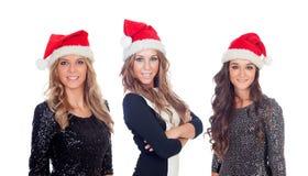 Eleganta kvinnor med julhatten Arkivbilder