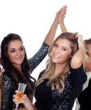 Eleganta kvinnor som firar jul som dansar i partiet Fotografering för Bildbyråer