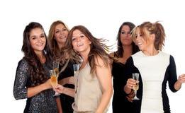 Eleganta kvinnor som firar jul som dansar i partiet Royaltyfria Bilder
