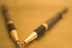 eleganta pennor två arkivbilder