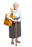 Elegante ältere Frau mit Spazierstock auf Weiß Stockfotos