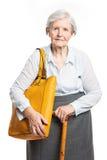 Elegante ältere Frau mit Spazierstock auf Weiß Stockbild