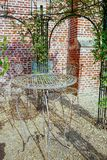 Elegante antiquiteit gevormde het meubilairreeks van de ijzertuin, hoge lijst royalty-vrije stock fotografie