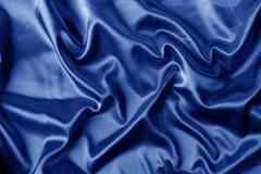 Elegante blauwe satijnachtergrond stock foto