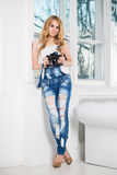 Elegante blonde Frau Stockfoto
