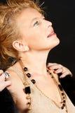 Elegante blonde Frau mit Portrait der blauen Augen Lizenzfreie Stockbilder
