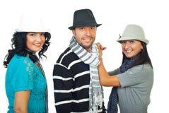 Elegante drei Leute mit Hüten Lizenzfreies Stockfoto