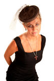 Elegante Frau mit einem Schleier auf ihrem Kopf Stockbilder