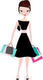 Elegante Frau mit Einkaufenbeuteln Lizenzfreie Stockfotografie