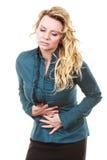 Elegante Frau mit Magenschmerzen Stockfotografie