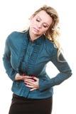 Elegante Frau mit Magenschmerzen Stockfotos