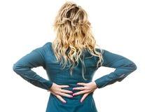 Elegante Frau mit schmerzlicher Rückseite Stockfotos