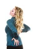 Elegante Frau mit schmerzlicher Rückseite Lizenzfreie Stockfotos