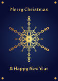 Elegante gouden sneeuwvlok op een diepe blauwe achtergrond, Kerstmiskaart Stock Foto