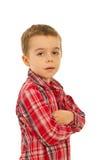 Elegante jongen met gevouwen wapens Stock Foto