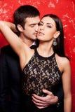 Elegante Paare auf Rot. Stockbild