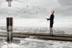 Elegante vrouweningenieur Gemengde media Stock Fotografie