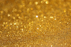 Eleganter abstrakter goldener Funkelnhintergrund Stockbild