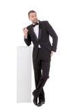 Eleganter schlanker Mann mit einem fragenden Ausdruck Stockbild