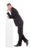 Eleganter schlanker Mann mit einem fragenden Ausdruck Lizenzfreie Stockfotografie