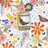 Elegantes Muster mit Blumen, Vogelkäfigen und Vögeln Stockfoto