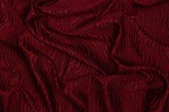 Elegantes rotes glänzendes Gewebe mit gewölbter Gewebebeschaffenheit lizenzfreies stockfoto