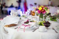 Elegantly catered luxury white tableware at wedding. Reception closeup Royalty Free Stock Image