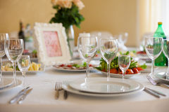 Elegantly catered wedding reception table: glasses, plates and s. Ilverware closeup Stock Image
