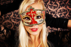 Elegantly dressed light hair model wearing a mask. Elegantly dressed, pretty, light hair model wearing a mask Stock Photography