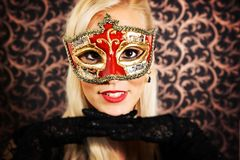 Elegantly dressed light hair model wearing a mask. Elegantly dressed, pretty, light hair model wearing a mask Stock Photos