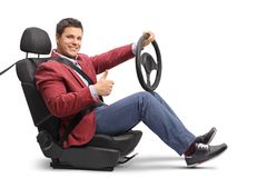 Elegantly dressed man seated in a car seat driving and making a Royalty Free Stock Photo