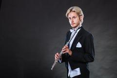 Elegantly dressed musician holding flute Royalty Free Stock Photo